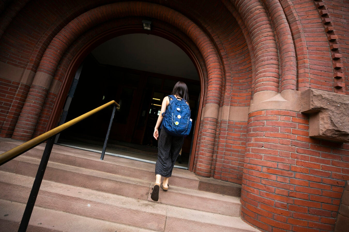 One student walks into Sever Hall.