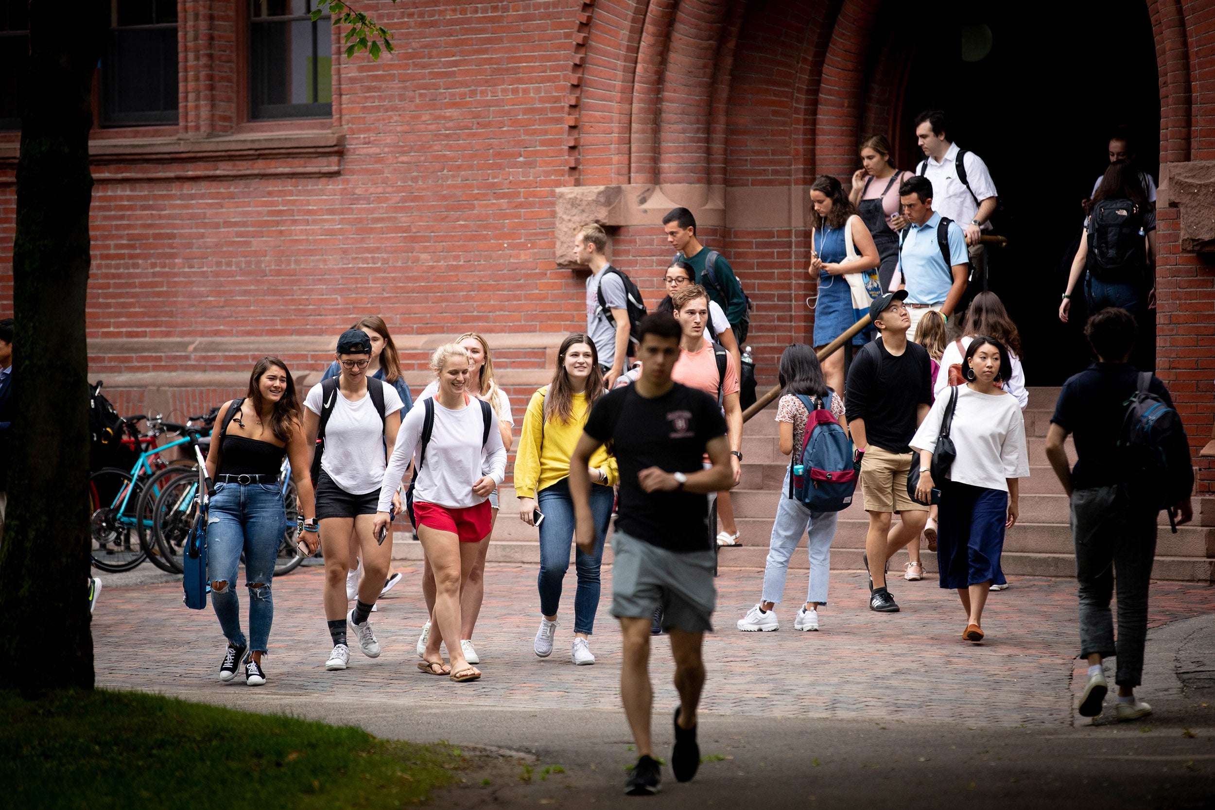 Students walk out of Sever Hall.