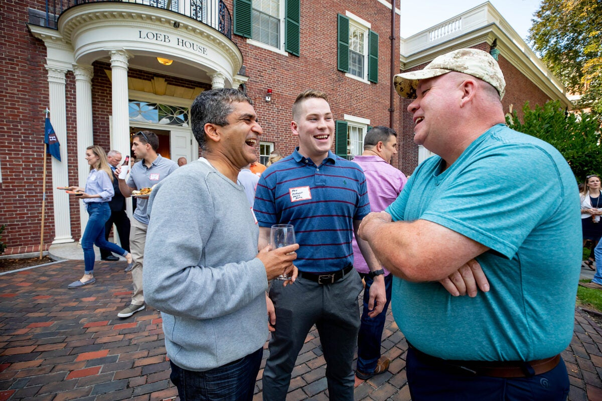 Father with sons in ROTC and the military talks with Harvard College dean.