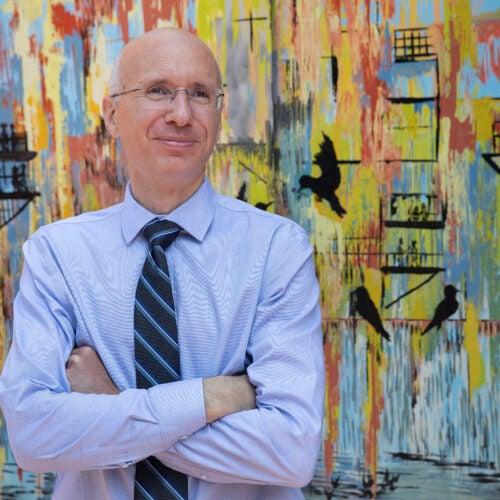 Aaron Bernstein standing in front of art