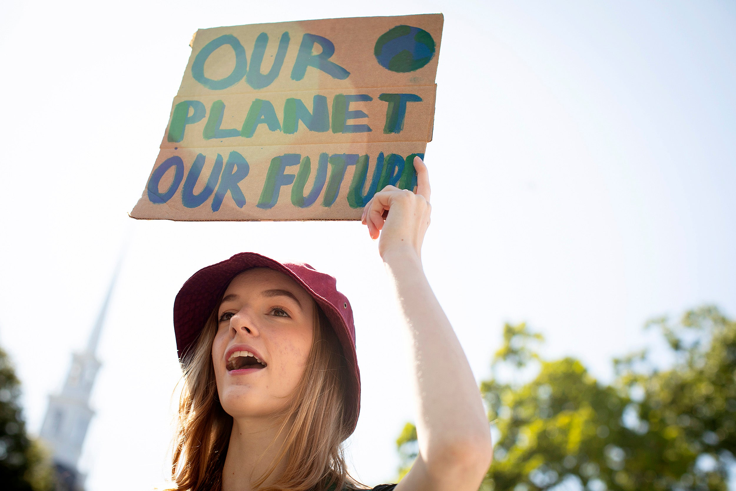 Harvard Strike for Climate Justice takes place on Harvard Science Center Plaza. Lily Hall '21 raises a sign during the rally.
