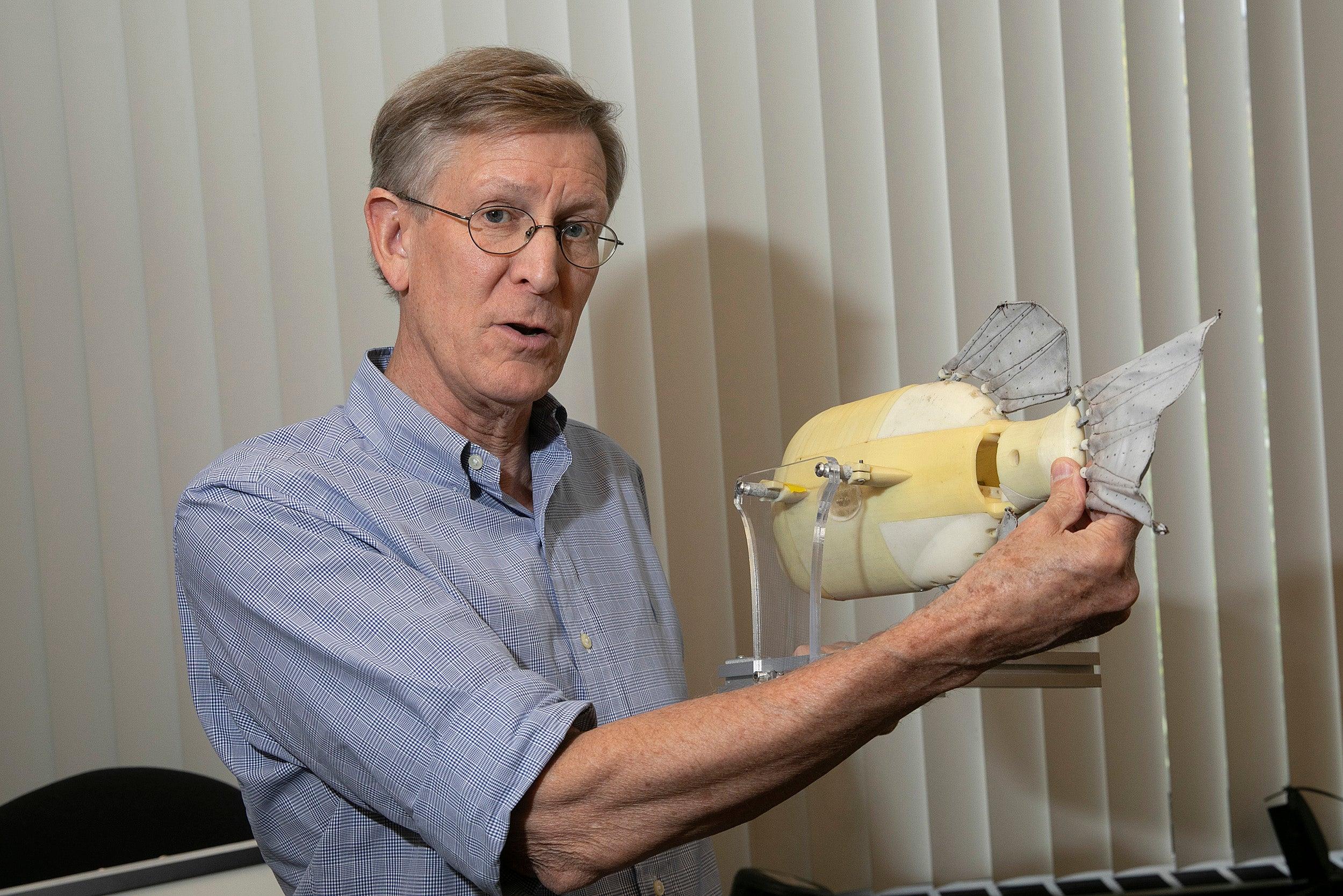 George Lauder holding a robotic fish