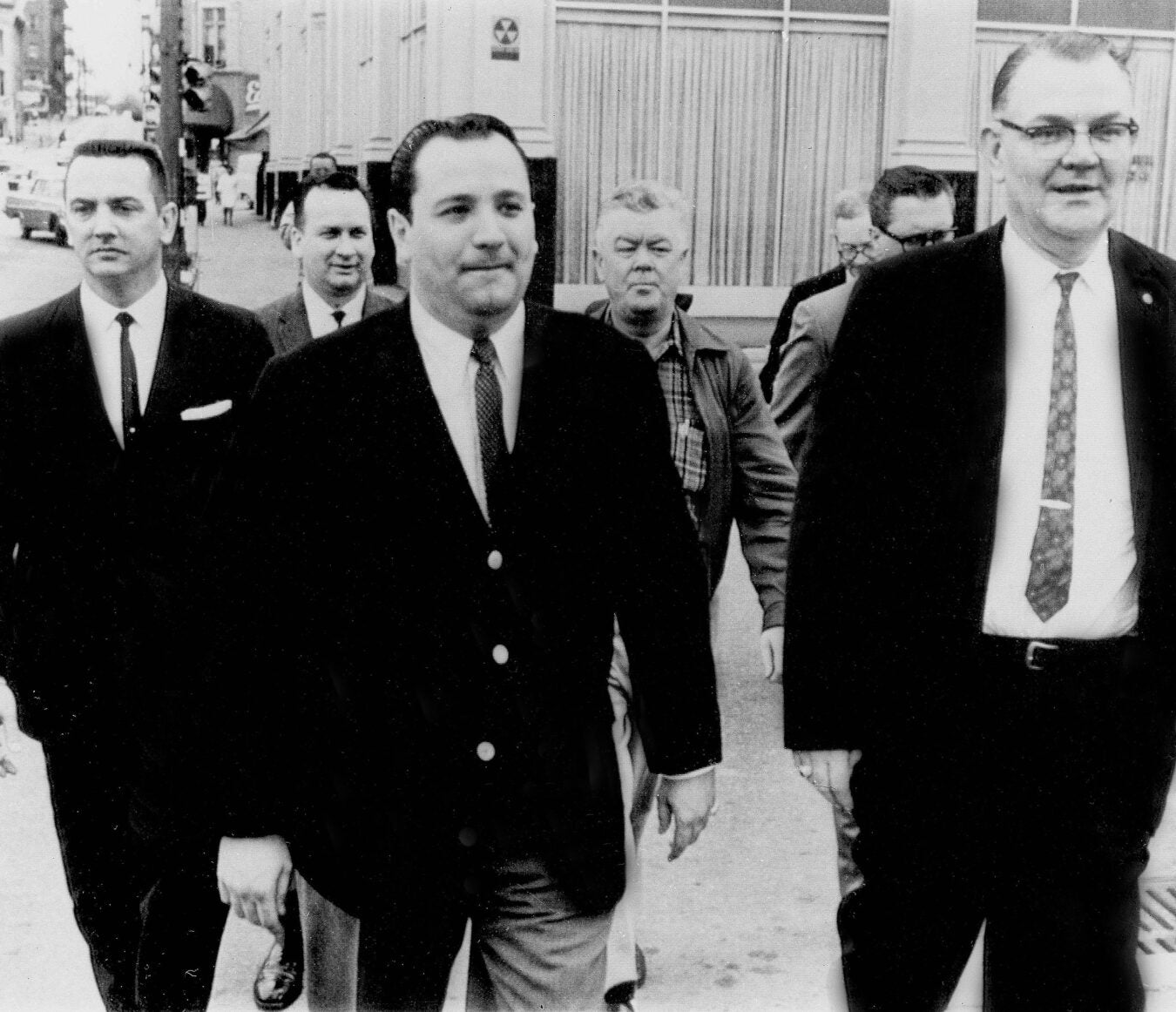 Charles L. O'Brien, center, is accompanied by U.S. marshals