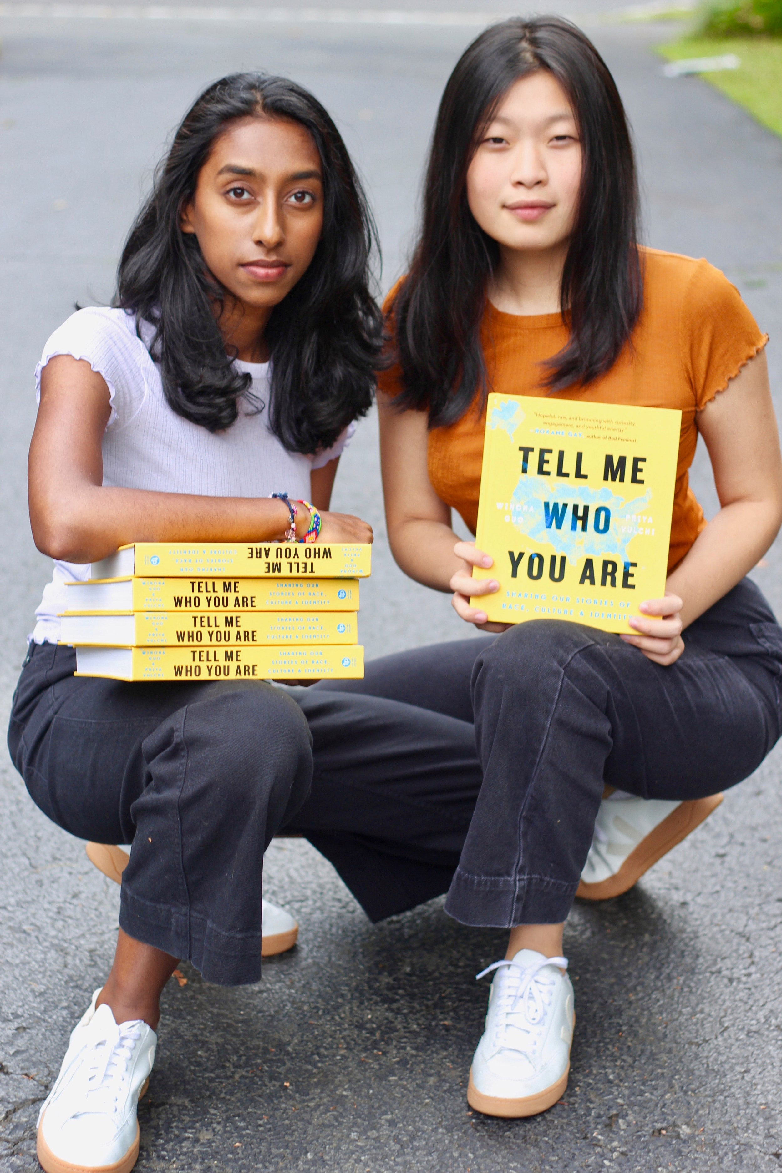 Priya Vulchi and Winona Guo with their recently published book.