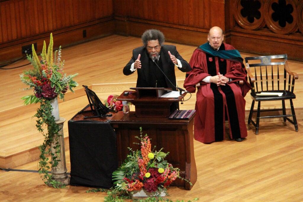 Cornel West at the podium.