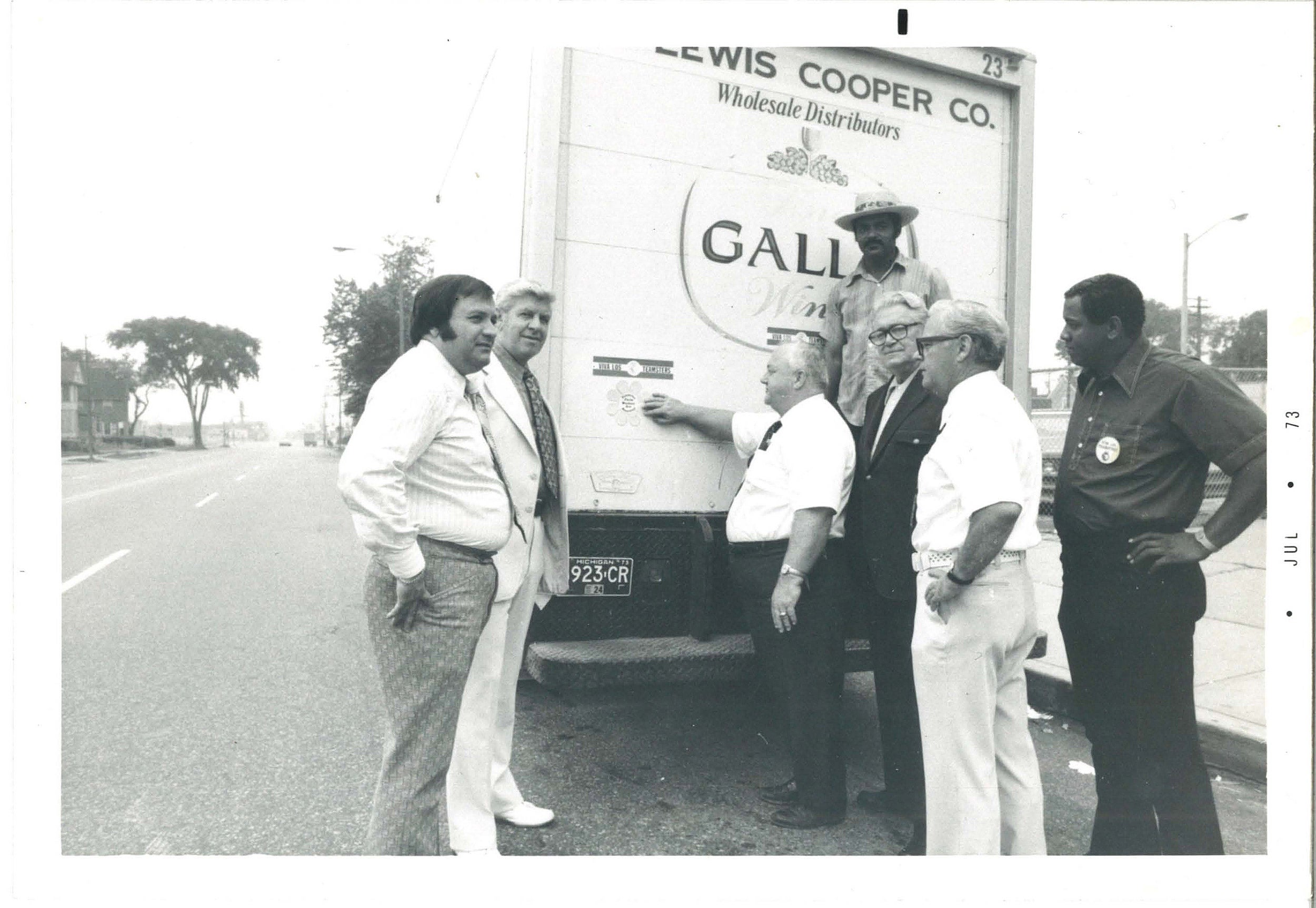 Men standing with a truck