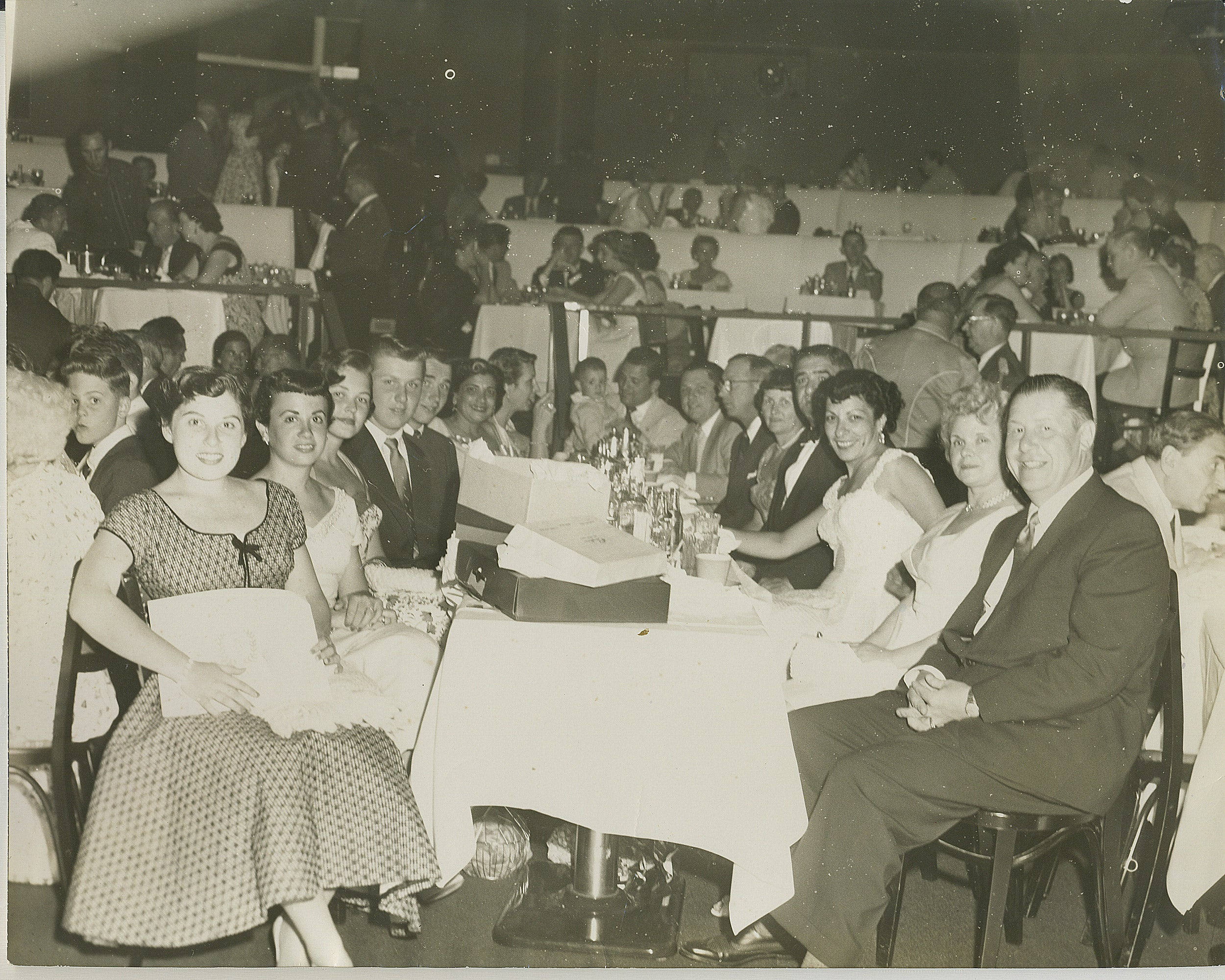 People sitting at a table at a celebration