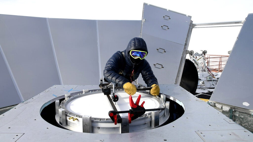 Installing a new vacuum window on the BICEP3 telescope.