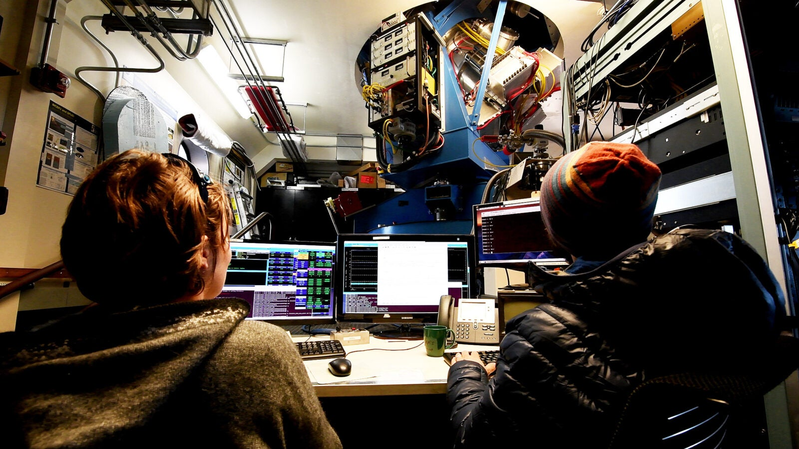 Marion Dierickx and Samuel Harrison operate the BICEP3 Telescope from inside the Dark Sector Laboratory.
