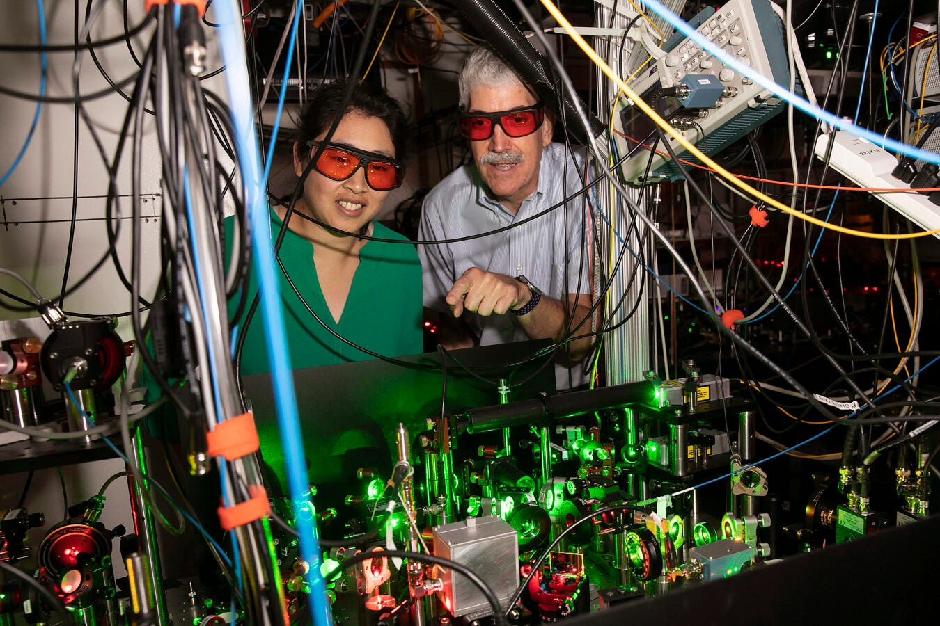 Using precisely focused lasers that act as optical tweezers