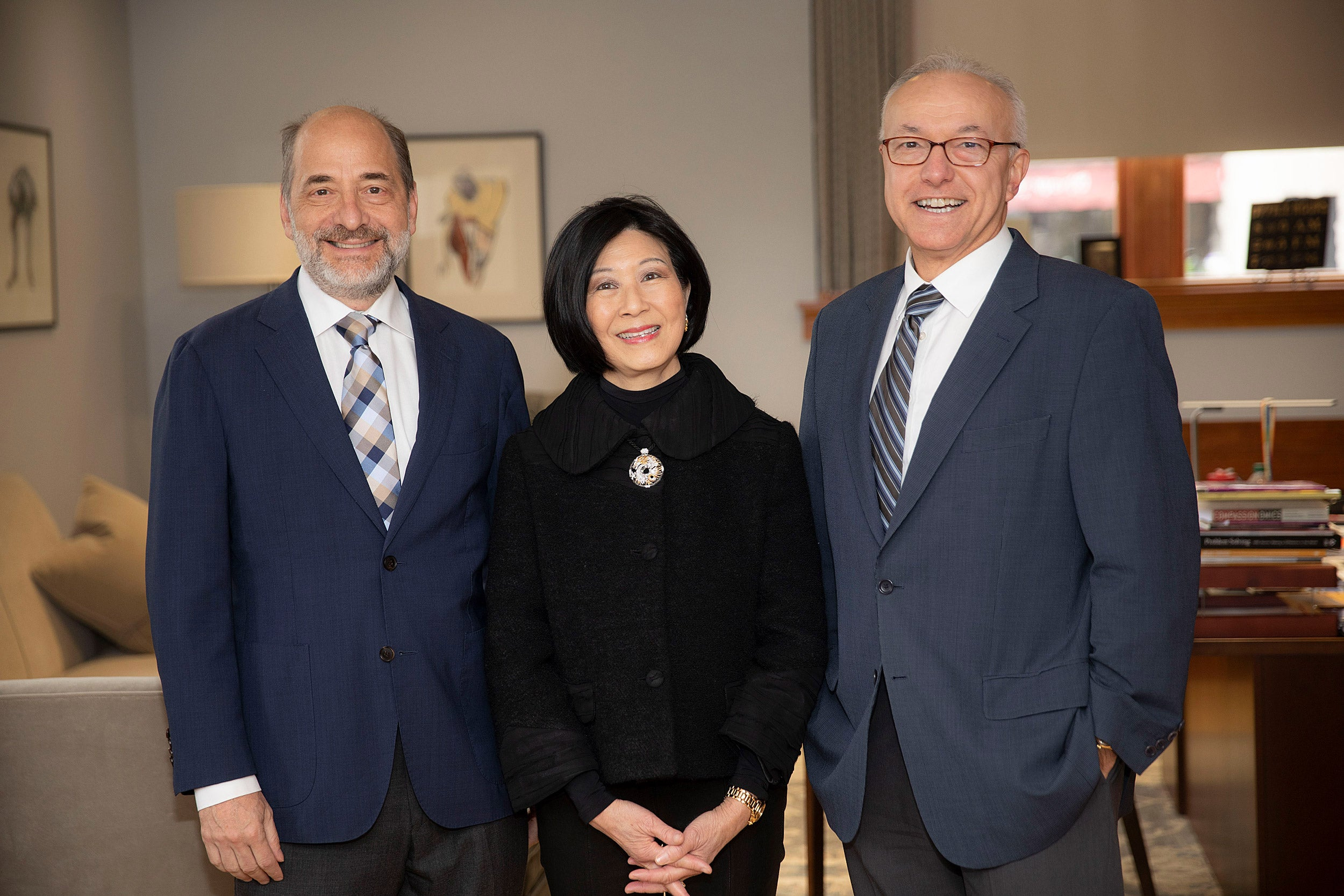 Professor Mike Greenberg, (from left) Lisa Yang, and Dean George Daley meet in Gordon Hall.