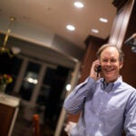 William G. Kaelin Jr. talks on phone after winning Nobel.
