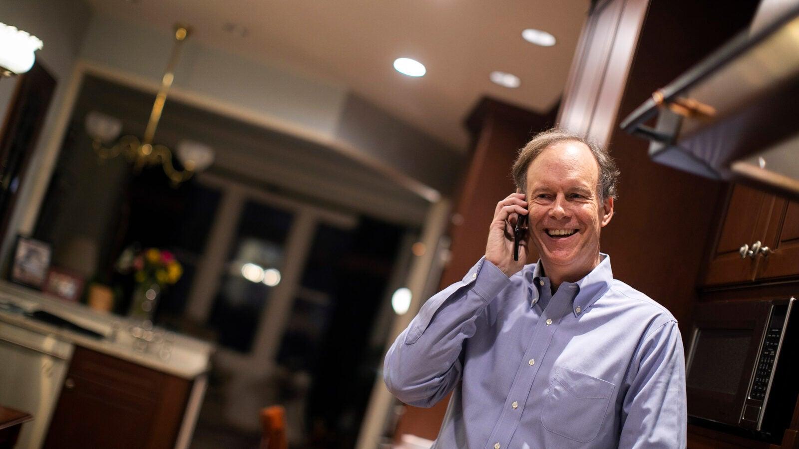 William G. Kaelin Jr. talks on phone after winning Nobel.