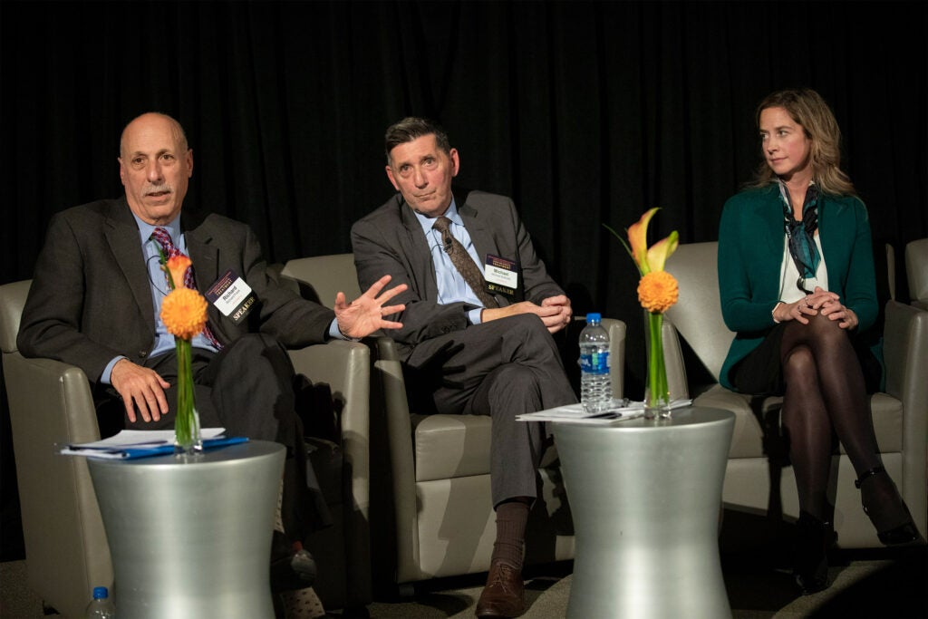 Richard Frank, HMS (from left), Michael Botticelli, Boston Medical Center, and Amy Bohnert, Univ. of Michigan speak inside the Martin Conference Center in the New