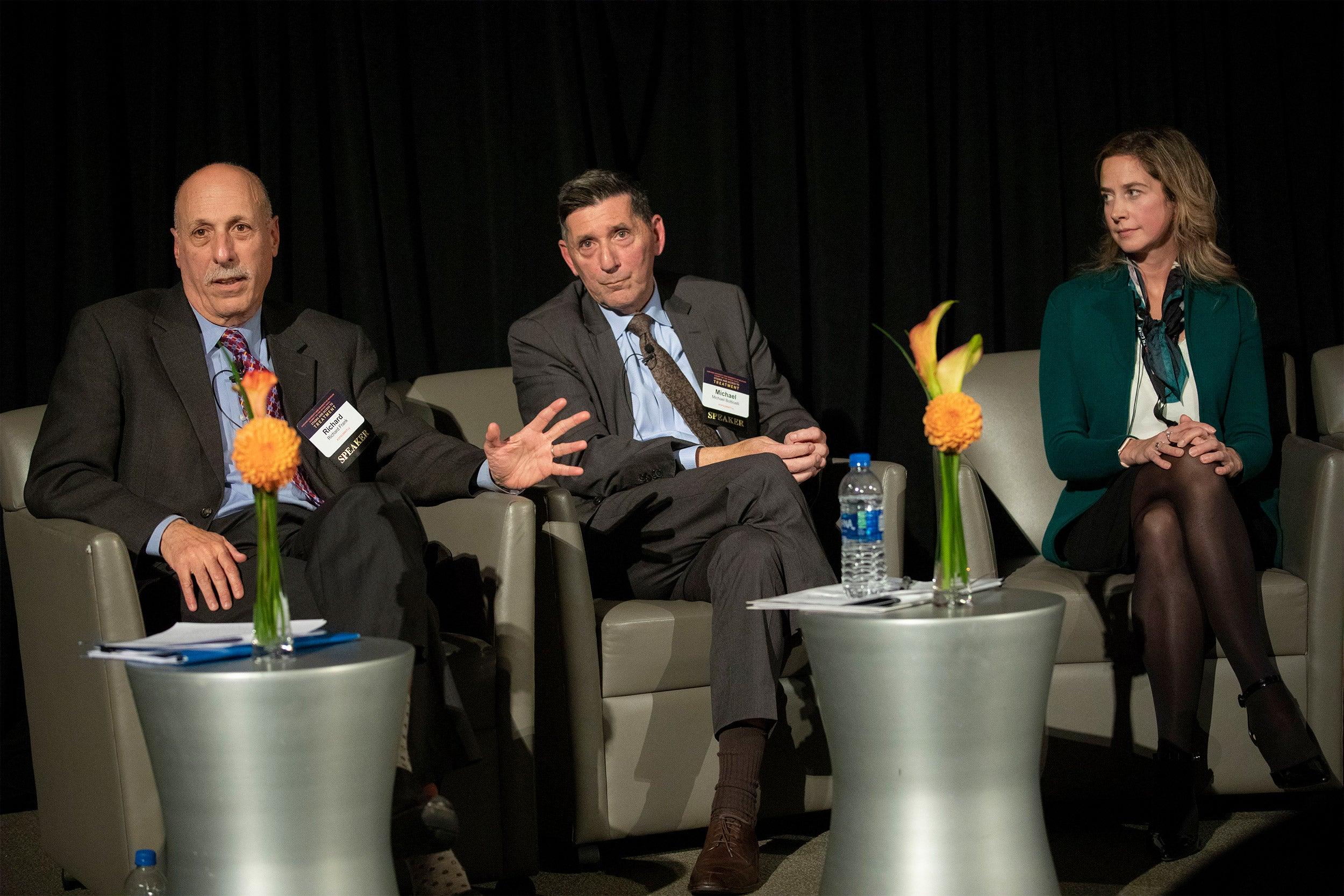 Richard Frank, HMS (from left), Michael Botticelli, Boston Medical Center, and Amy Bohnert, Univ. of Michigan speak inside the Martin Conference Center in the New