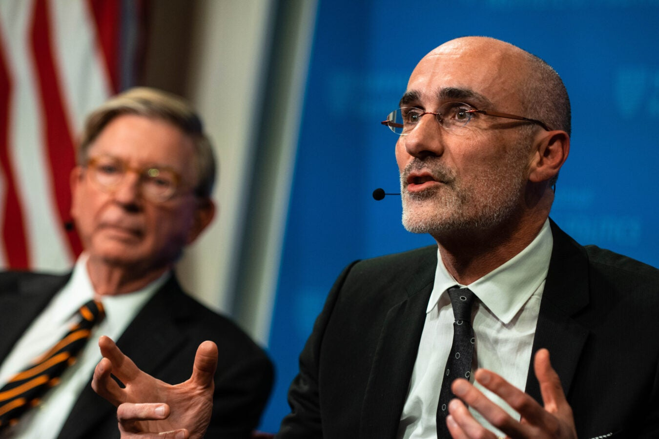 Harvard Kennedy School Professor Arthur Brooks with George Will in the background.