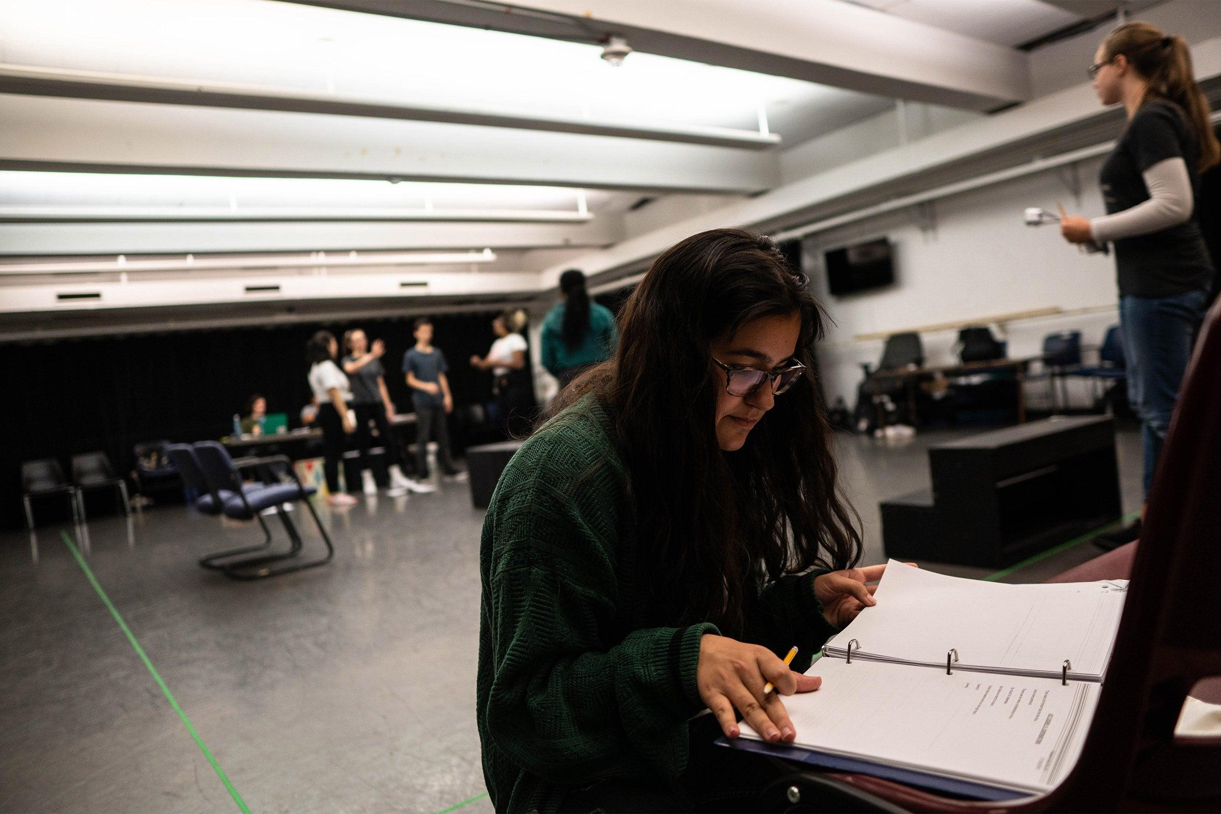 Daniella Santana of Mary Lyon Pilot High School reads her script.