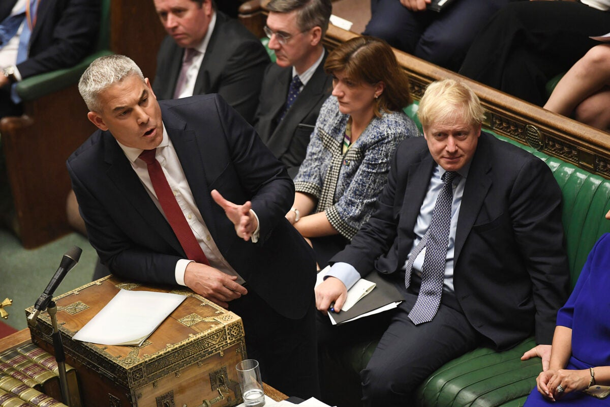 Secretary of State for Exiting the European Union lawmaker Stephen Barclay speaks during the Brexit debate, watched by Prime Minister Boris Johnson (right) inside the House of Commons in London on Oct. 19.