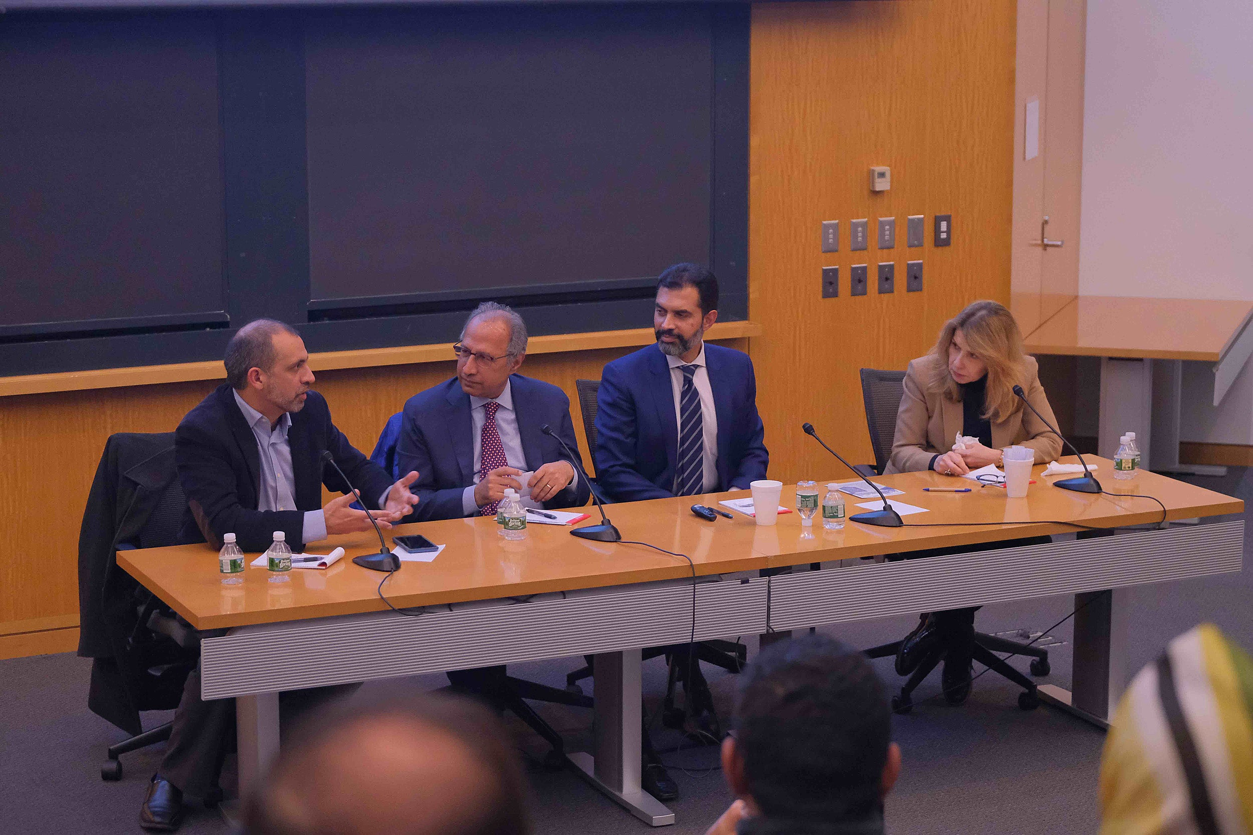 Four panel members speaking