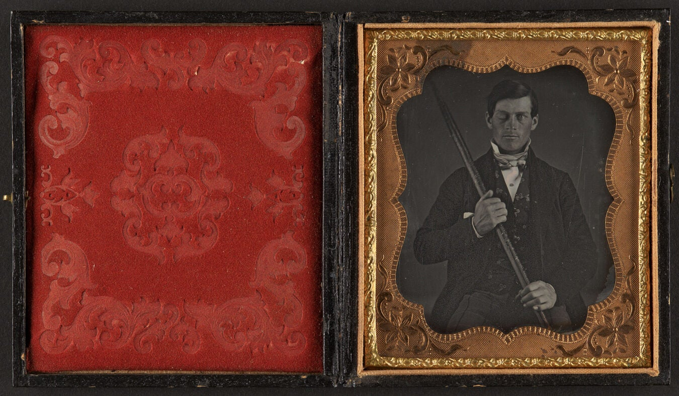 Black and white photo of Phineas Gage in a small black and gold frame
