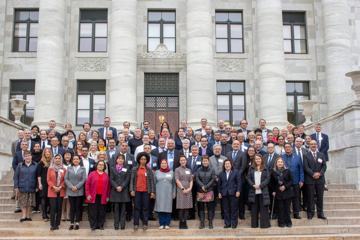 Group photo of symposium participants on the steps of Harvard Medical School