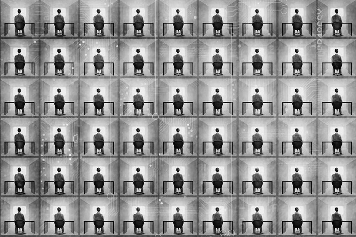 Person sitting at a desk in a black and white grid