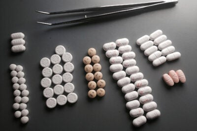 Pills laid out on a table.