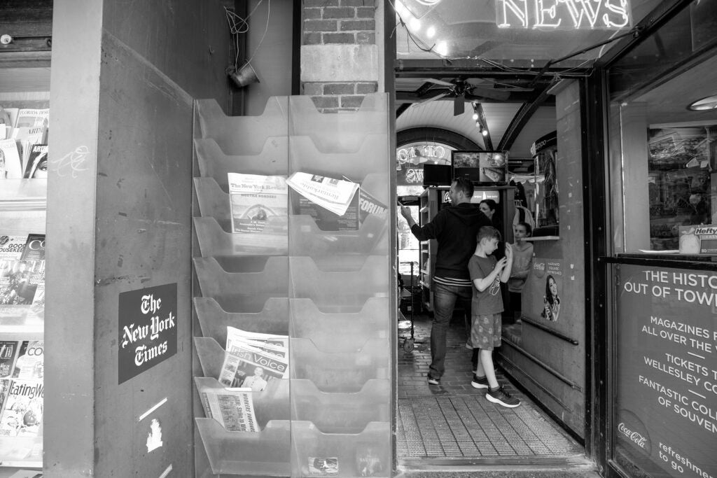 Looking inside the newsstand.