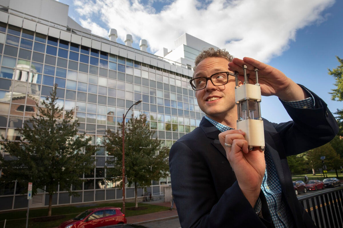 Christoffer Abrahamsson holding a small device