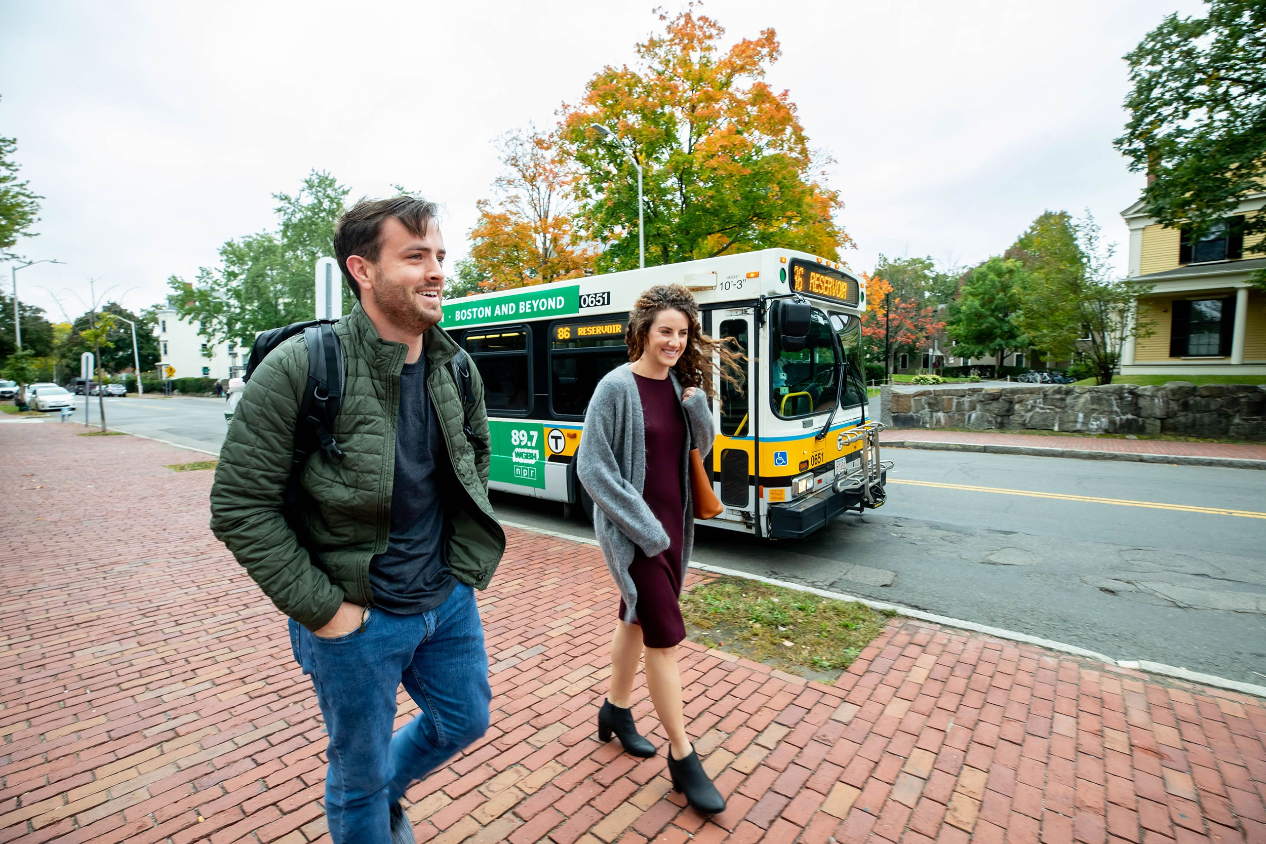 First-year student Hudson Miller and his wife, Hannah Miller, commute by bus to Harvard.