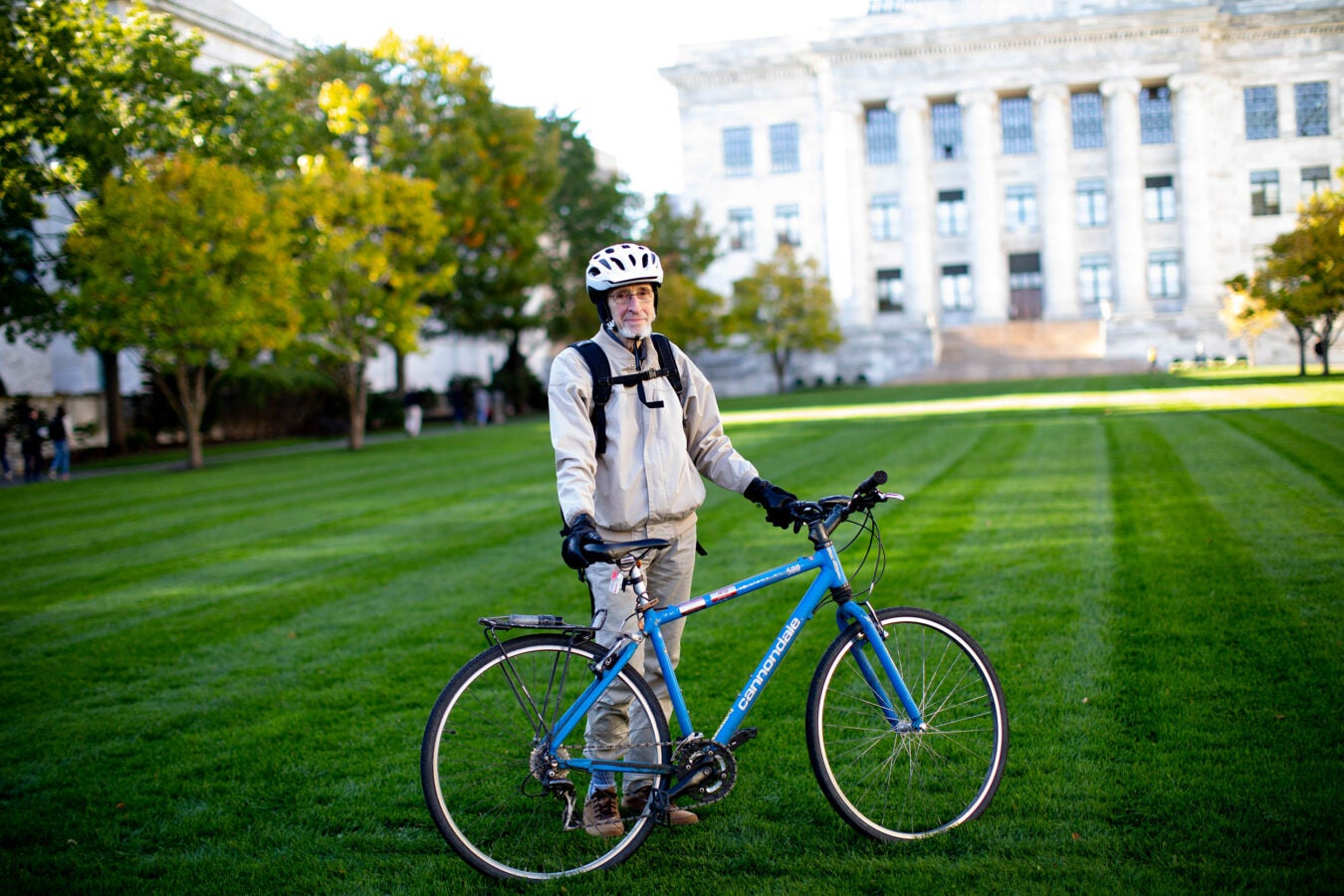 Jonathan Beckwith stands alongside his bicycle at Harvard Medical School.