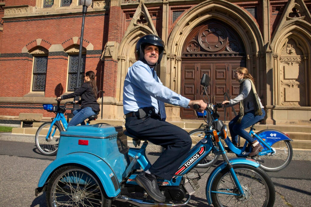 David Seley uses an old three-wheel moped to commute to Annenberg Hall, where he works.