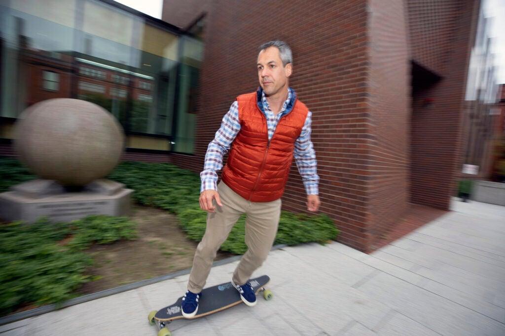 Matthew Liebmann rides a skateboard.