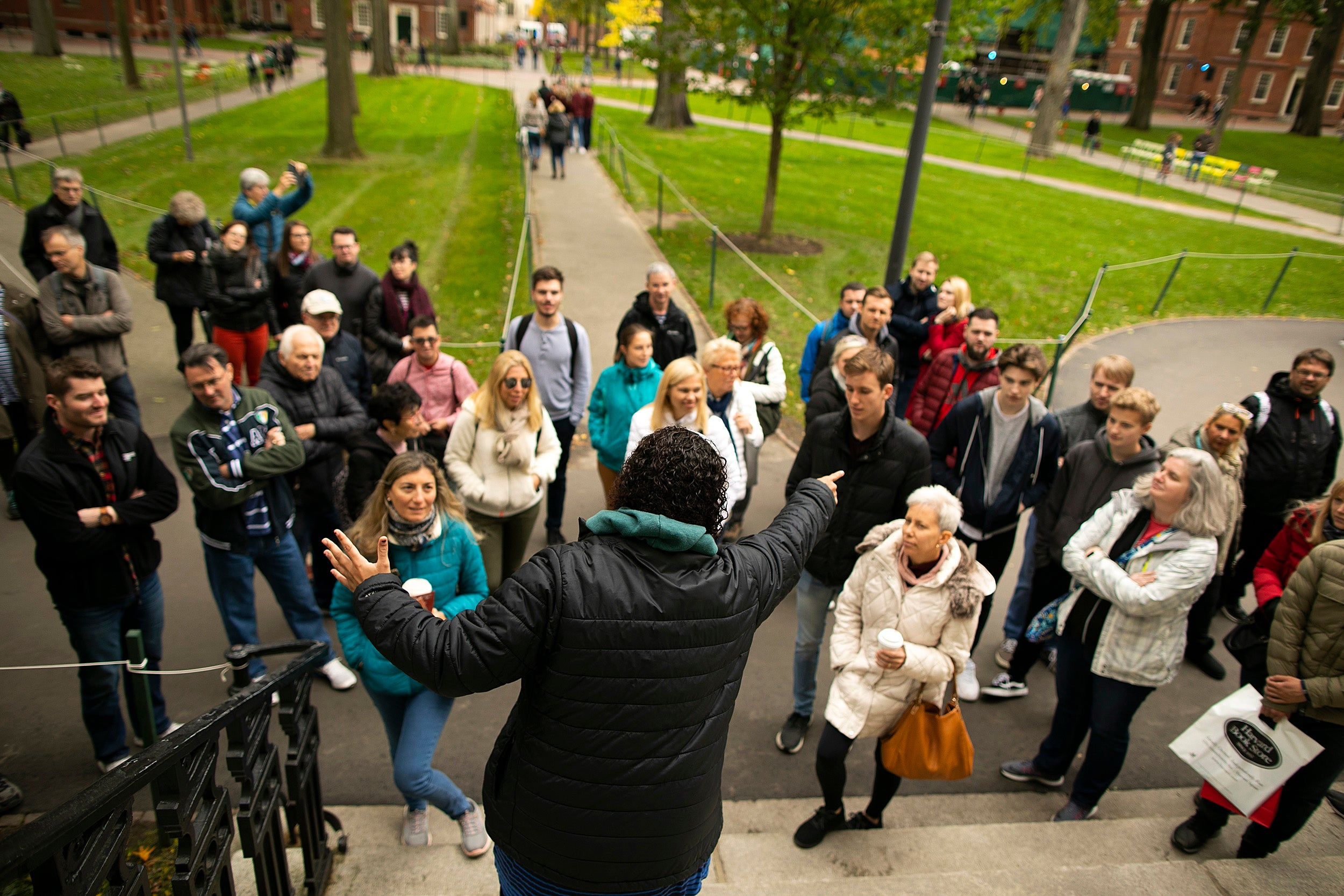 Rachel Gilchrist faces tour group in Harvard Yard.