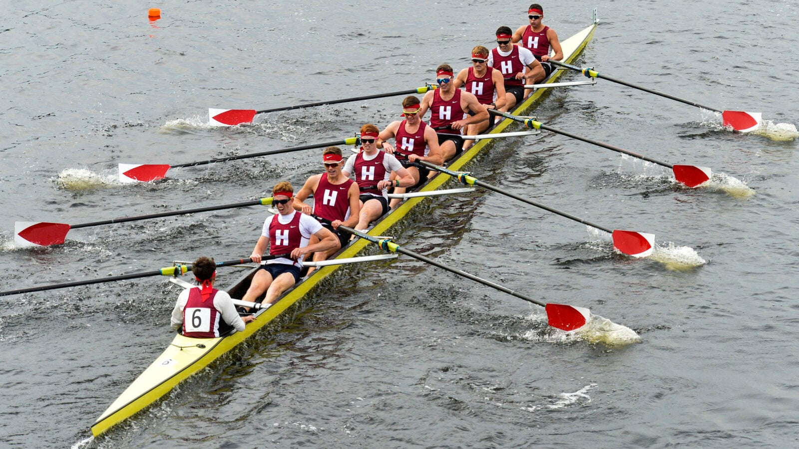 Harvard's heavyweight boat passes beneath the Weeks Footbridge in the men's championship eights race during the Head of the Charles.