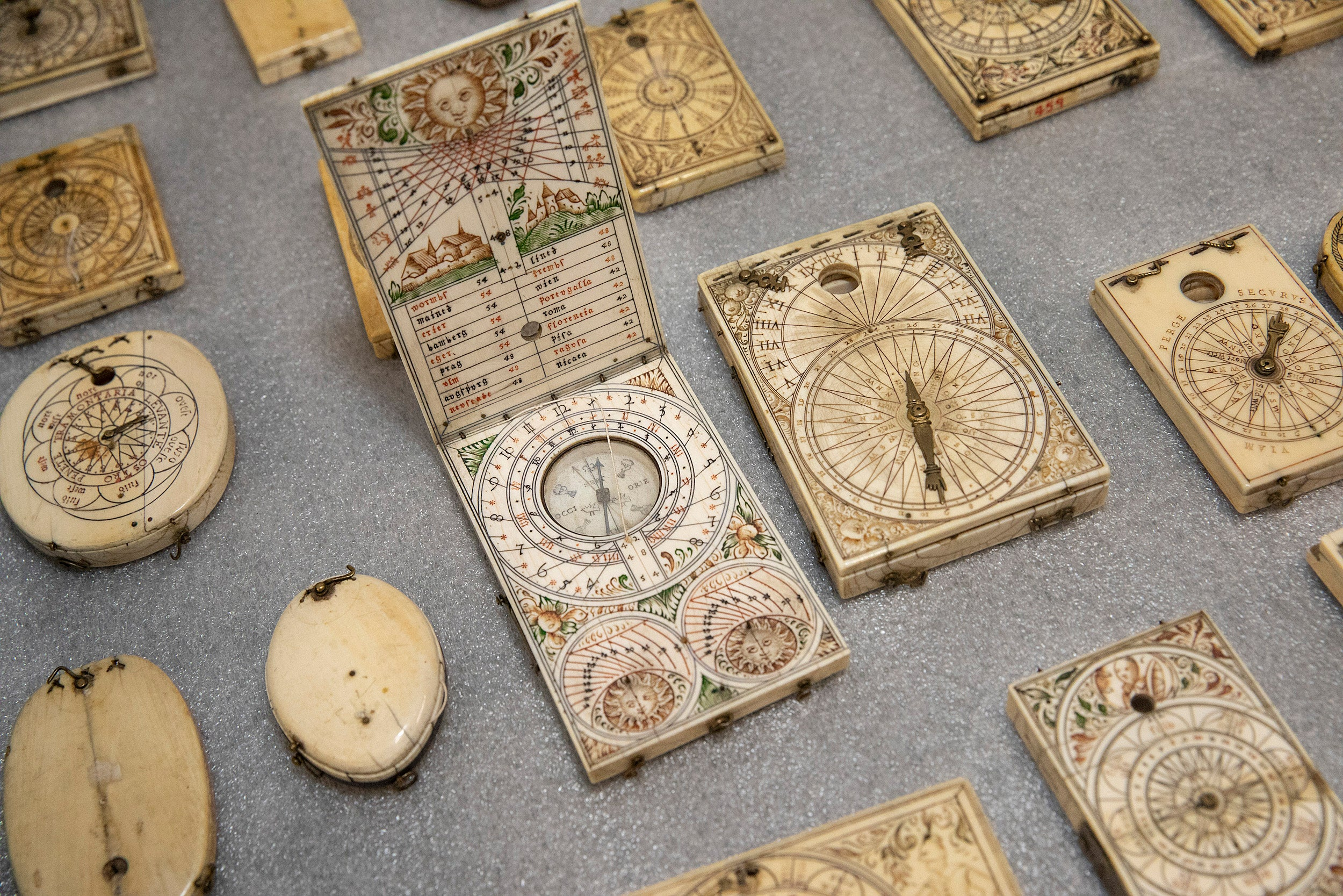 Picture of different kinds of ivory pocket sundials.