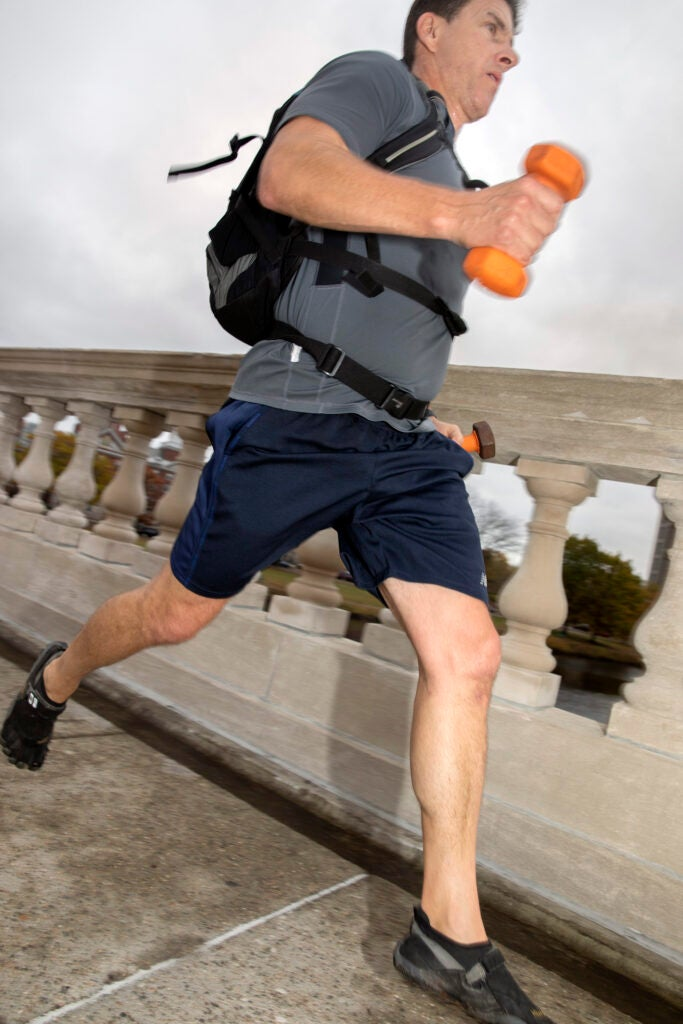 Joseph Henrich runs to work across the Weeks Bridge.