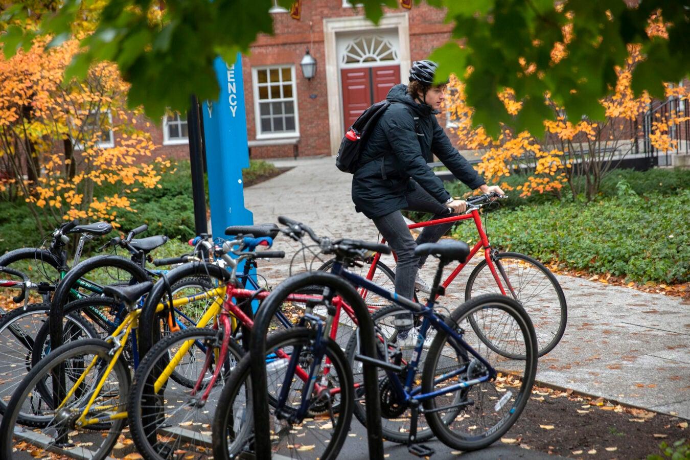 Hugo Milner rides his bike outside Dunster House
