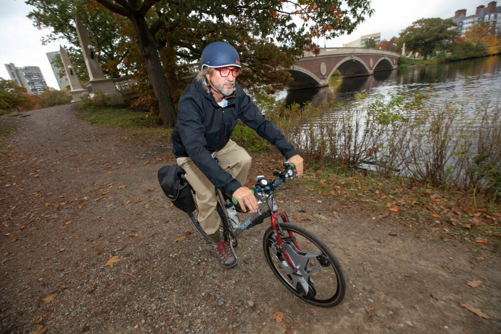 Lance Schumacher rides his e-bike near the Weeks Bridge.