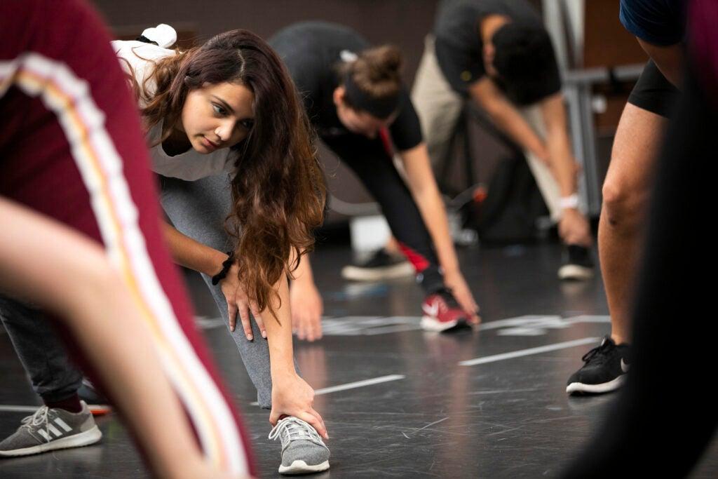 Marie Alejandra Konopacki stretches during class.