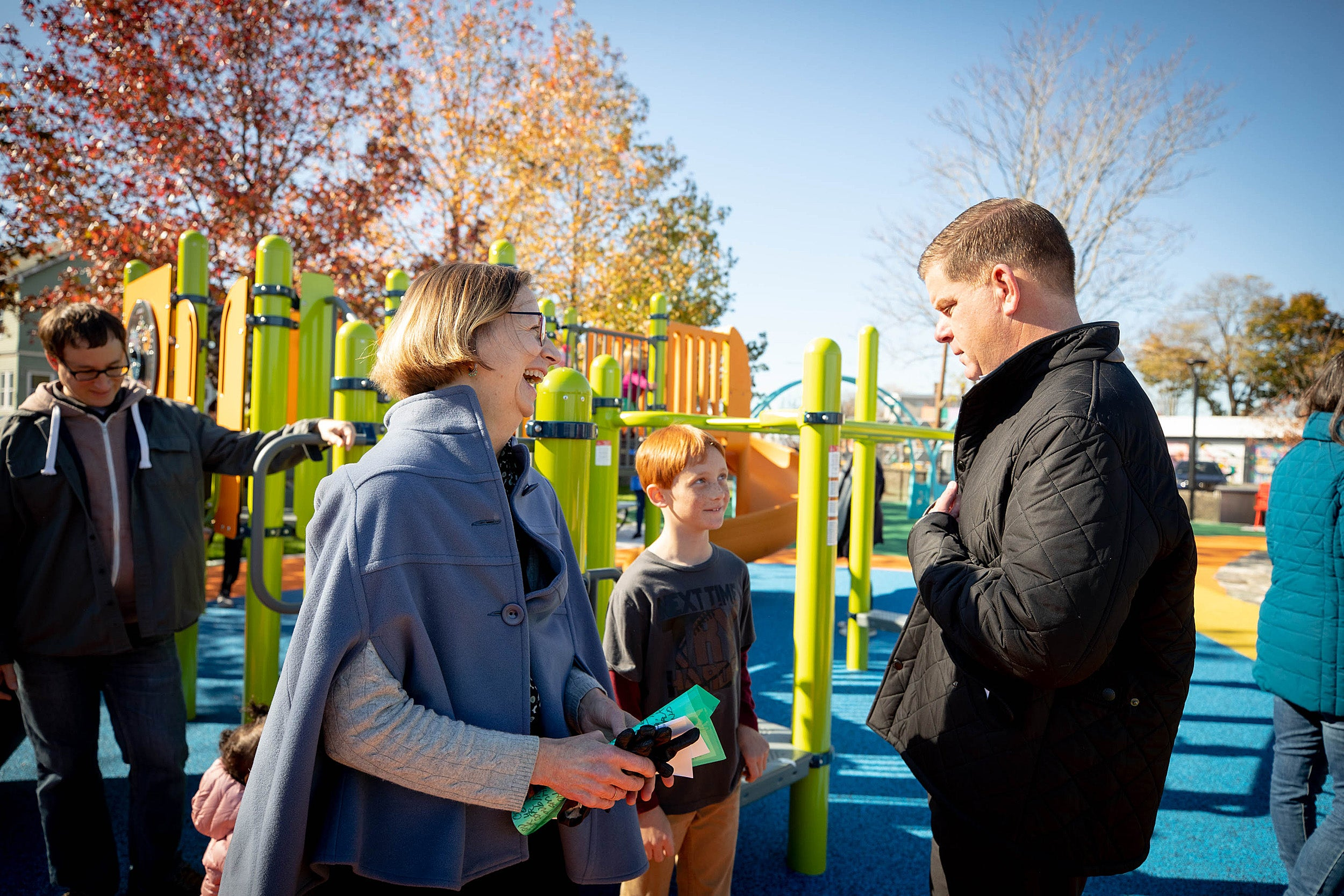 Marty Walsh talks to Katie Lapp and a child on a playground
