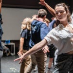 Performers rehearse choreography