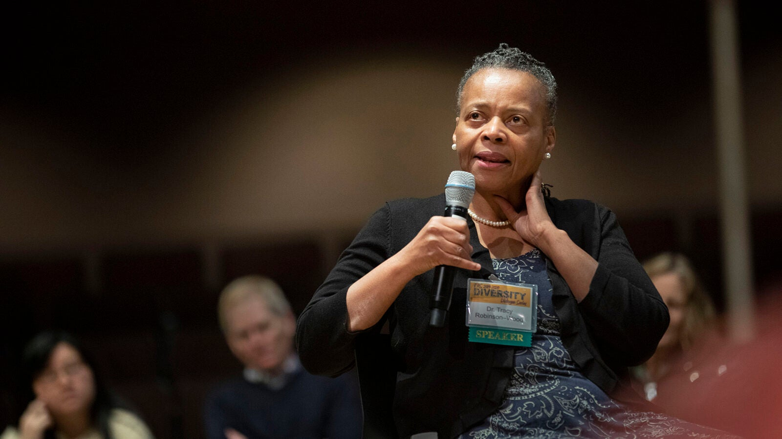 Tracy Robinson-Wood speaking on a microphone