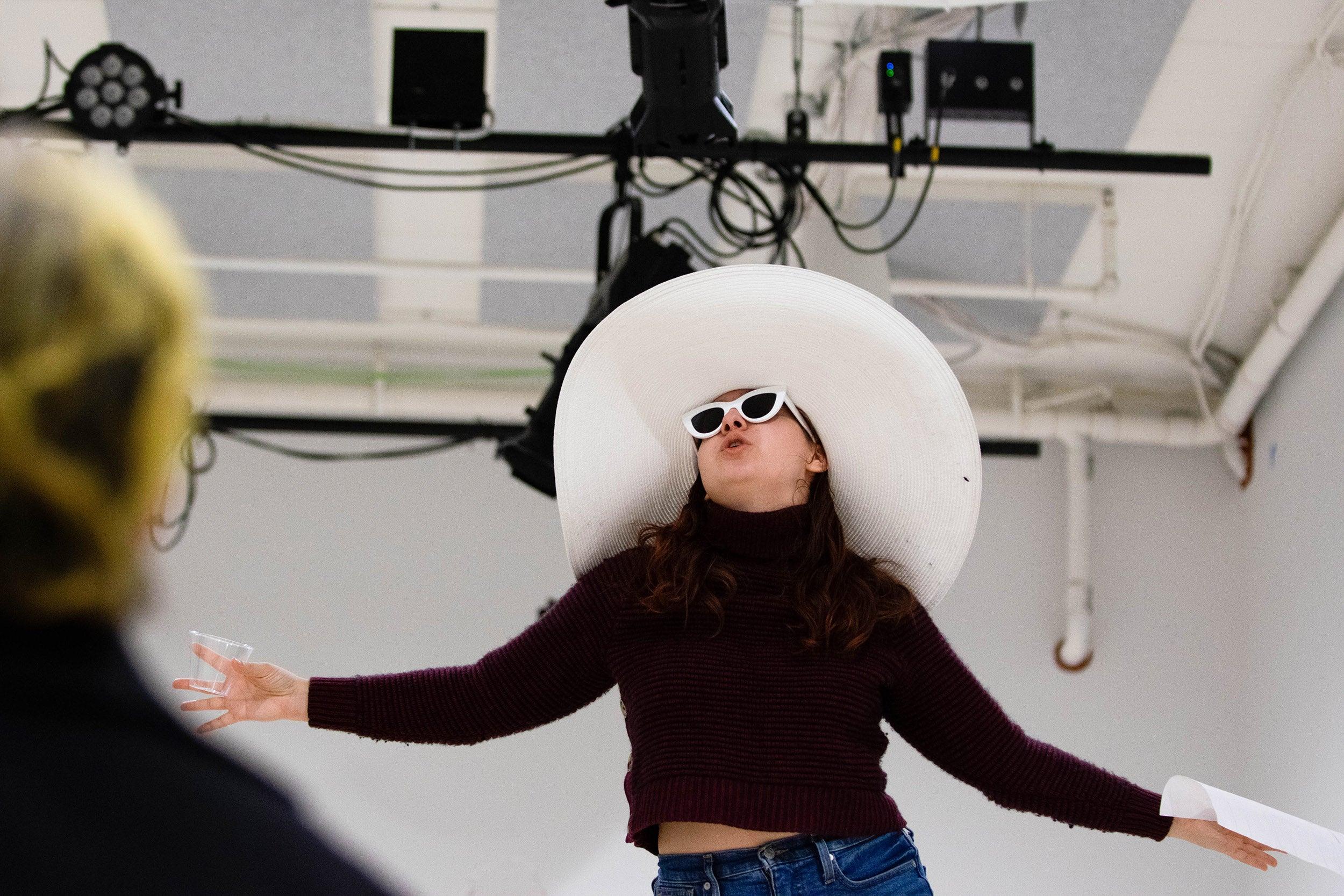 Allie Jeffay raises her hands during rehearsal.