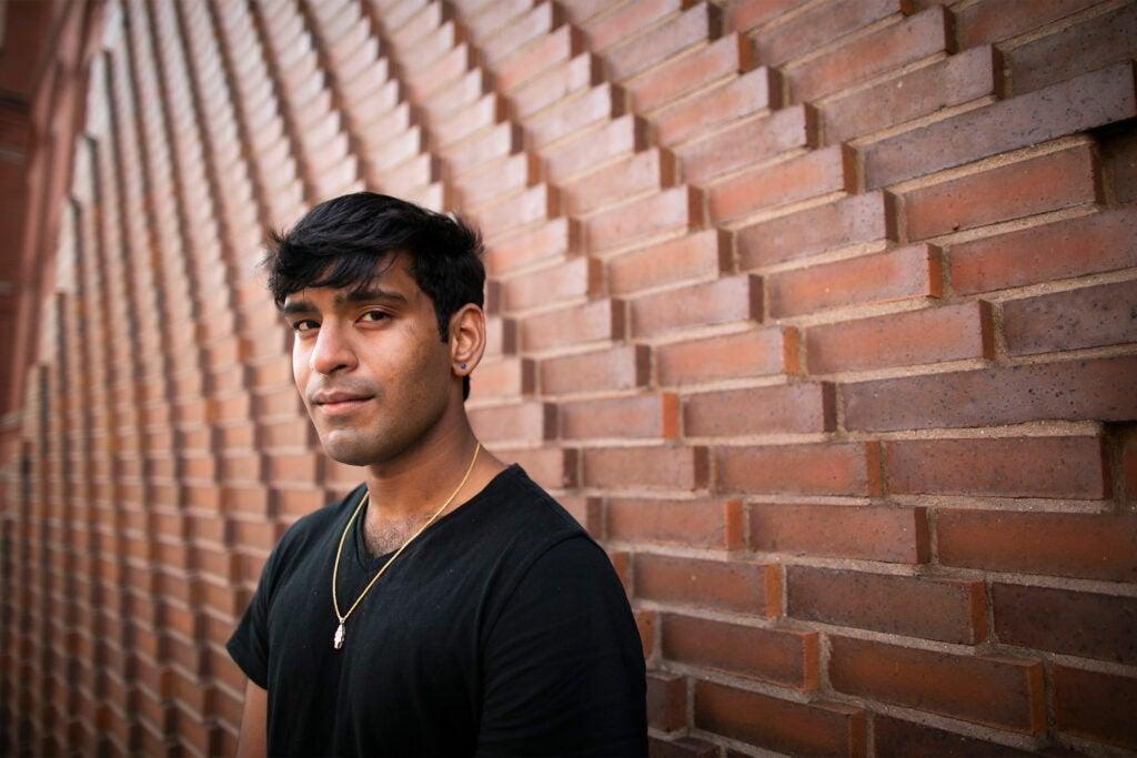 Sai Shanthanand S. Rajagopal standing against a wall at Harvard.