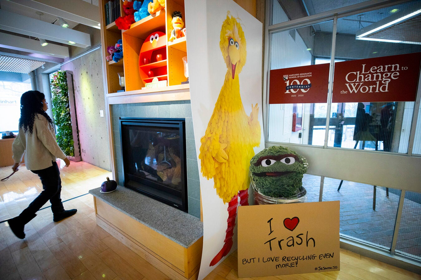 Shelving over a fireplace at the Ed School is lined with Sesame Street toys.