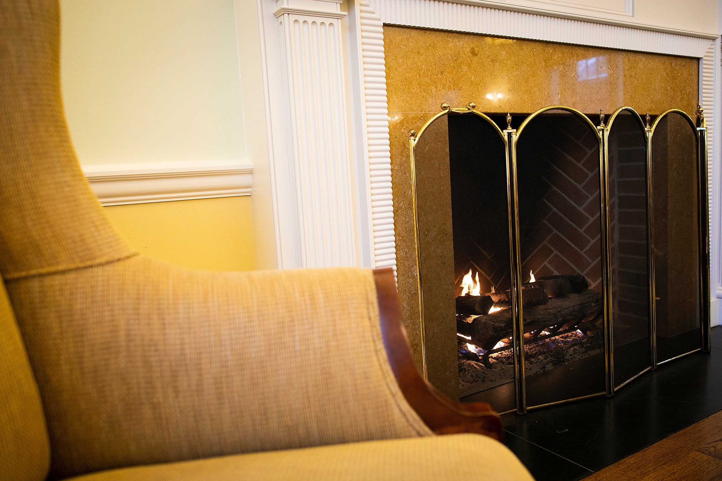 Gold and white fireplace at the Business School.