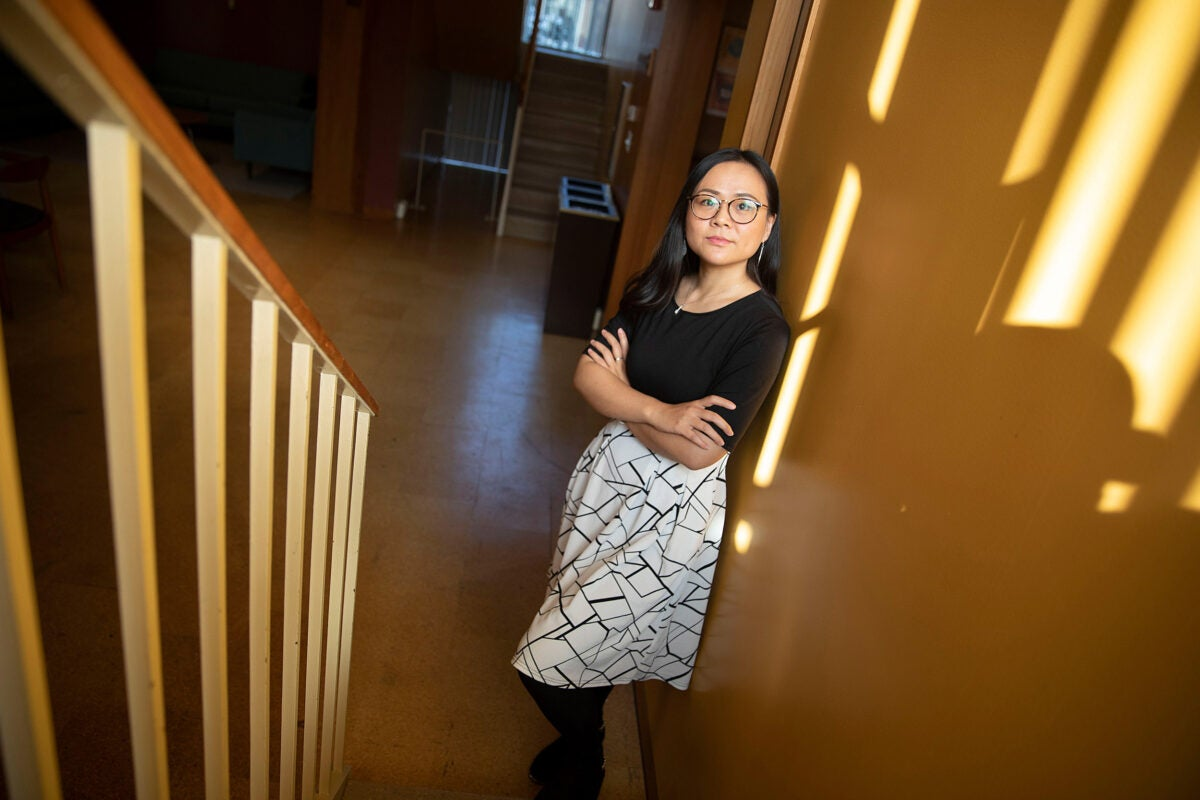 Asian woman standing in stairwell.
