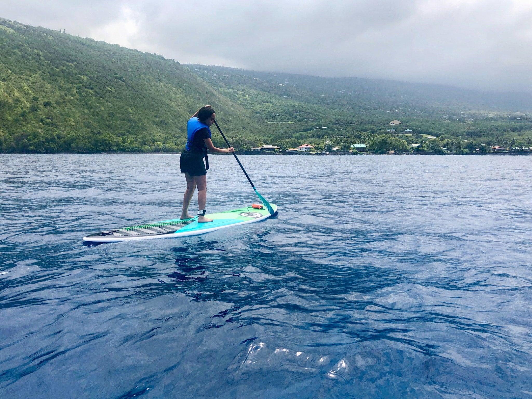 Girma paddle boarding in Hawaii