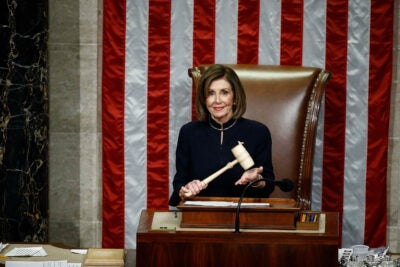 House Speaker Nancy Pelosi holds the gavel.